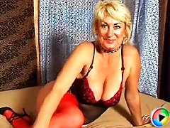 short haired blond granny with huge melons gives blowjob